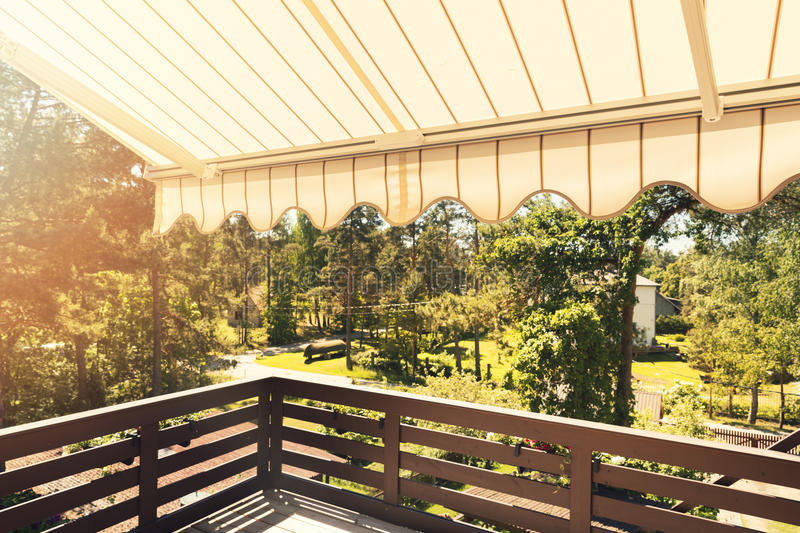 Awning over balcony terrace on sunny day royalty free stock photography