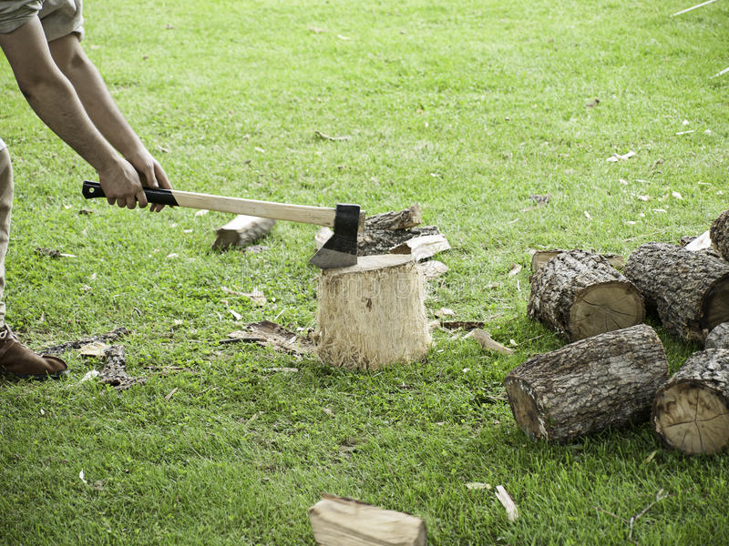 Ax cutting firewood stock images