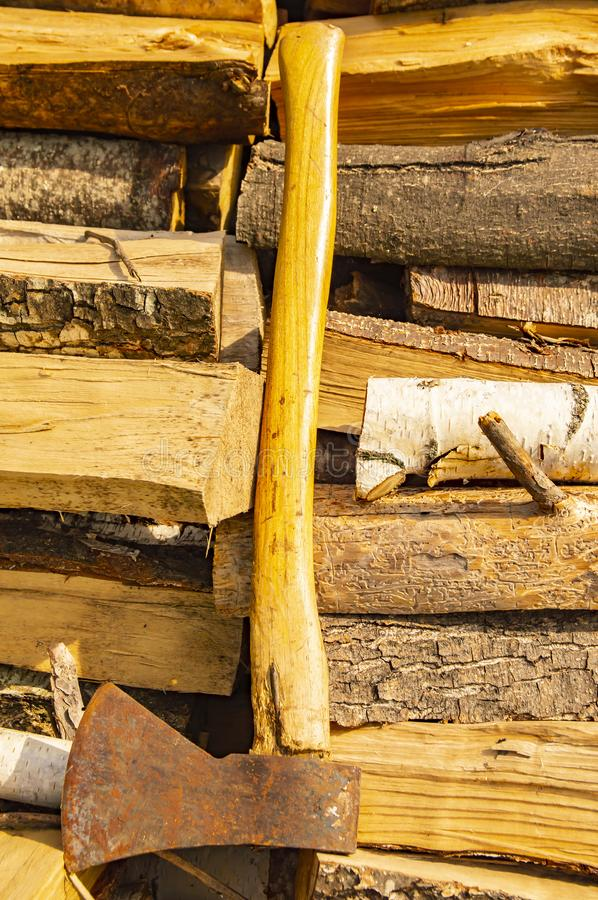 The ax lies on the stacked chopped wood - deforestation royalty free stock photography