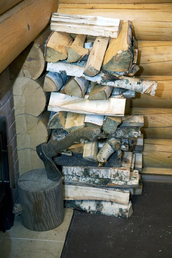 Ax and pile of split wood. In the bath stock images