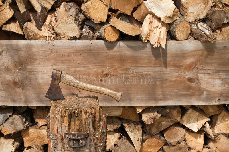 Ax stuck and cut wood stock images
