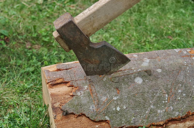 Ax in tree stump stock images