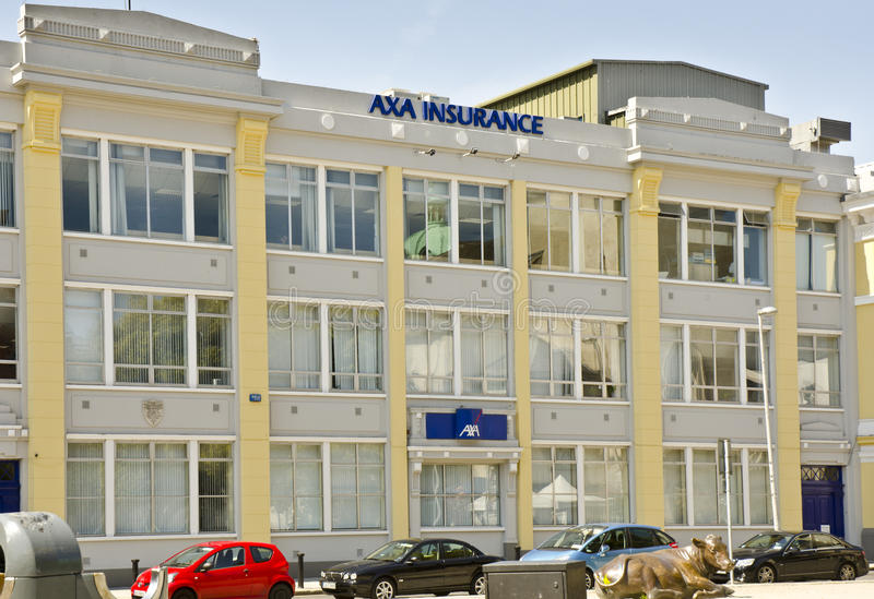 AXA Insurance offices. DUBLIN, IRELAND - MAY 25: the offices of AXA Insurance on May 25, 2013 in Dublin, Ireland. AXA is the world's largest insurance company by royalty free stock image