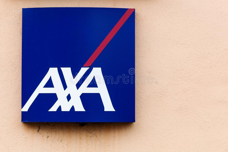 AXA logo on a wall. Saint Georges, France - March 20, 2016: AXA is a French multinational insurance firm headquartered in Paris that engages in global insurance royalty free stock photography
