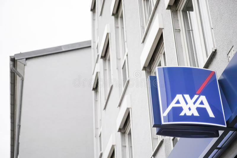 Axa. Sign of the Axa insurance on a building - focus is on the sign, copy space to the left royalty free stock photography