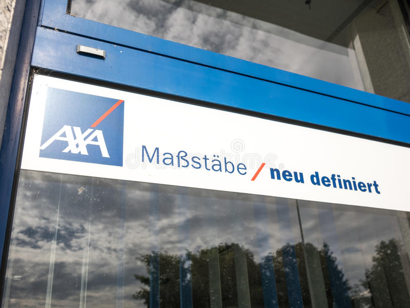 AXA slogan. Sign on a window of the german AXA insurance with their slogan - selective focus is on the left stock photo