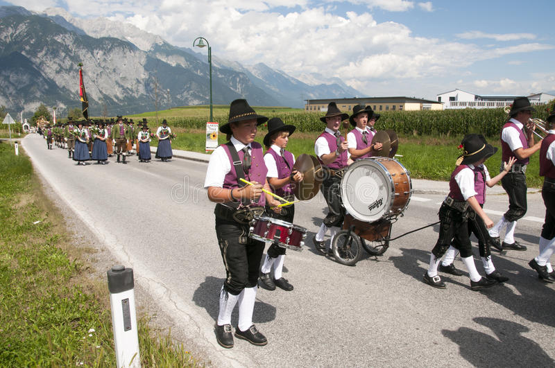 Children making music in procession. AXAMS,AUSTRIA - AUGUST 15:Unidentified people making music in procession to the church on Maria Ascension,on August 15, 2012 royalty free stock photos