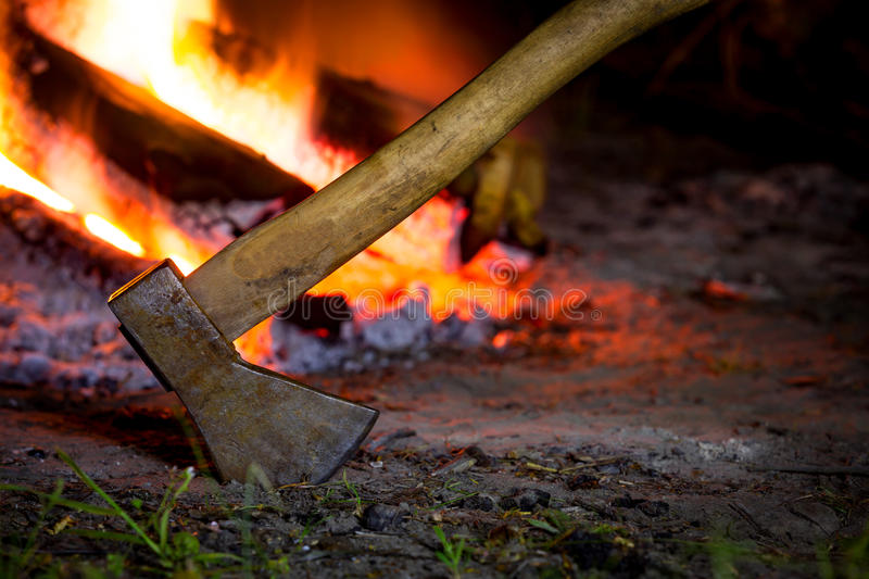 Axe and fire. Axe in darkness against hot fire royalty free stock photography