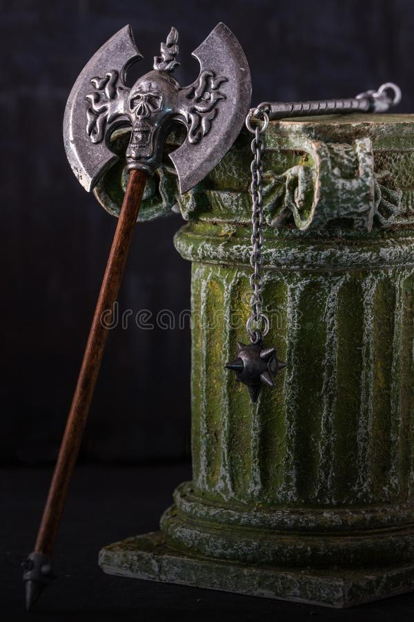 Double axe and flail over column royalty free stock photography