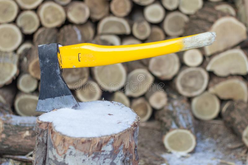 Axe in log, stack of firewood royalty free stock photo