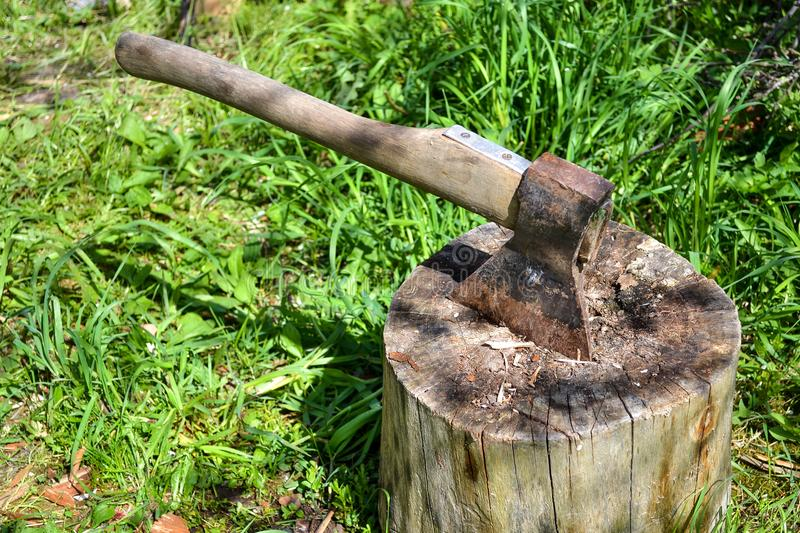 Axe in stump. Axe ready for cutting timber.Woodworking tool. Travel, adventure, camping gear, outdoors items royalty free stock photography