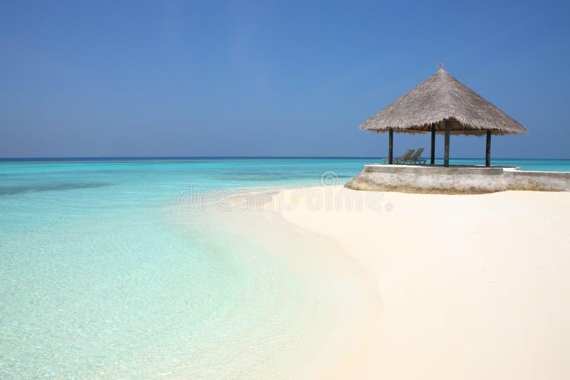 Axe sur la plage des Maldives photo stock