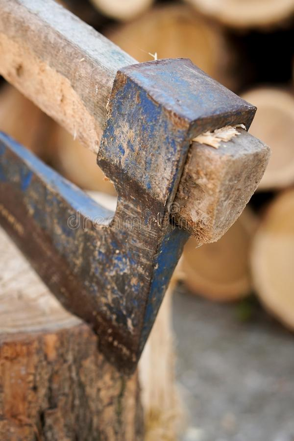 Axe in wood. With blurred background royalty free stock photos