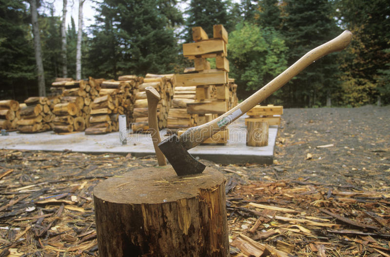 Axe and woodpile, Copper Harbor, MI stock photos