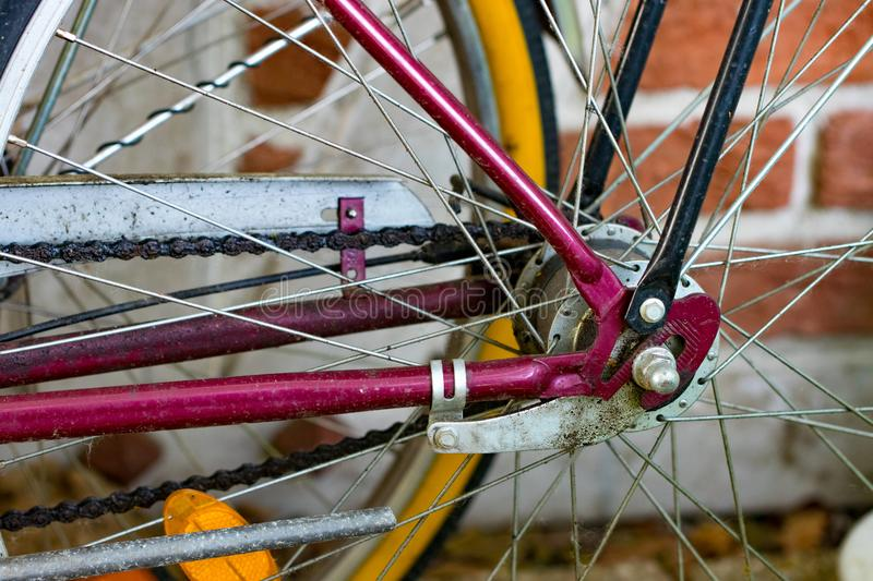 Axel and spoke section close-up of bicycle wheel in a cycle work stock photo