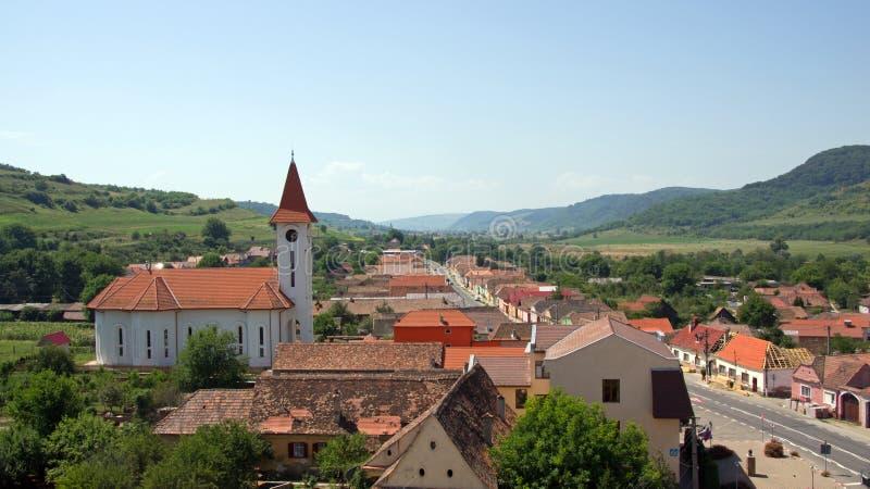Axente Sever in Romania. White church of Saxon village Axente Sever or Frauendorf in Transsylvania stock images