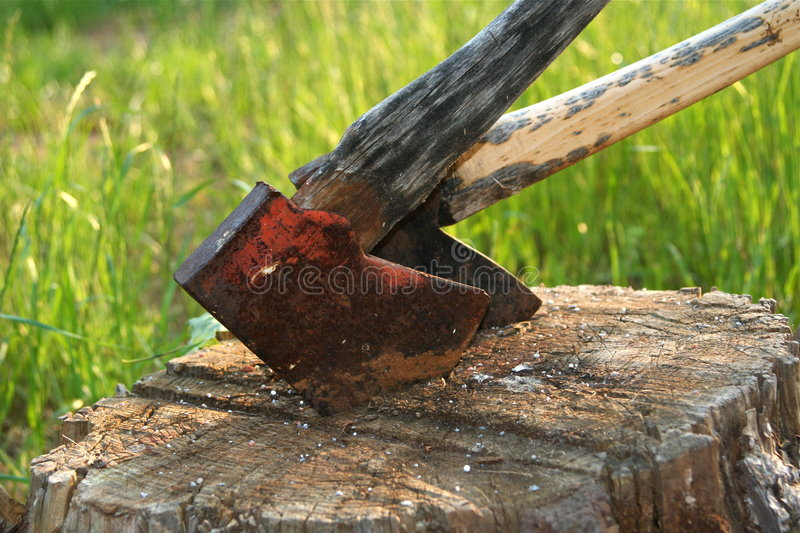 Axes. Two axes in a tree stump royalty free stock photo