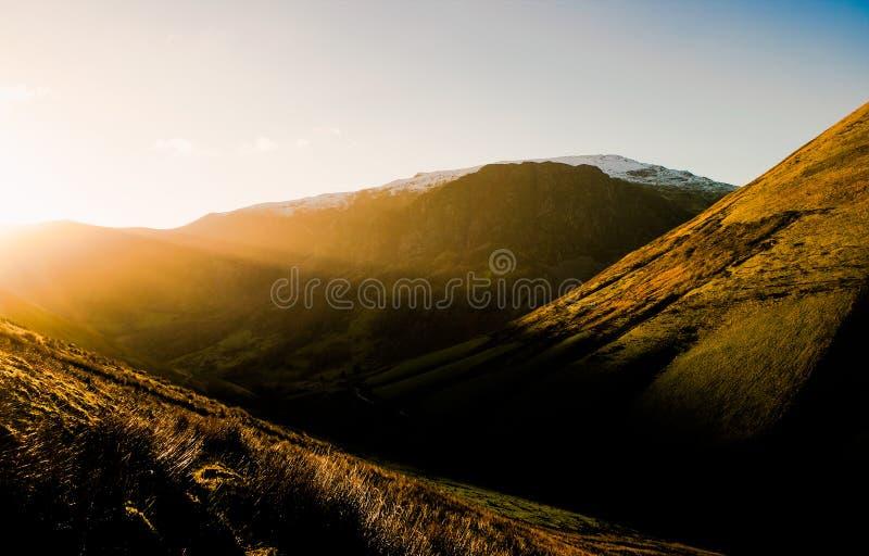 Axes de lumière du soleil au Pays de Galles photographie stock