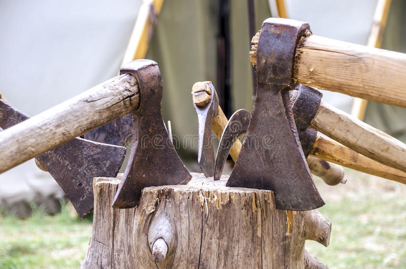 Axes in stump.  royalty free stock photography