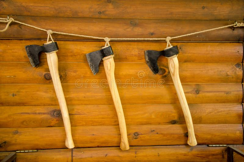 Axes on the wall. For sale stock image