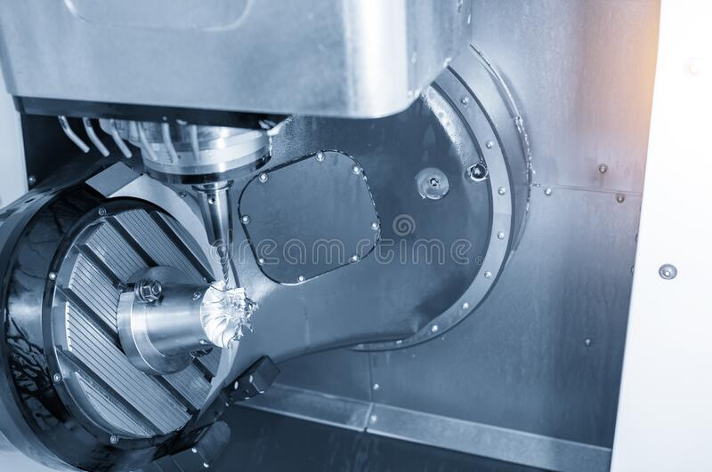 The 5-axis CNC milling machine cutting the aluminium turbine propeller part by solid ball endmill tools. The 5-axis CNC milling machine  cutting the  aluminium royalty free stock image