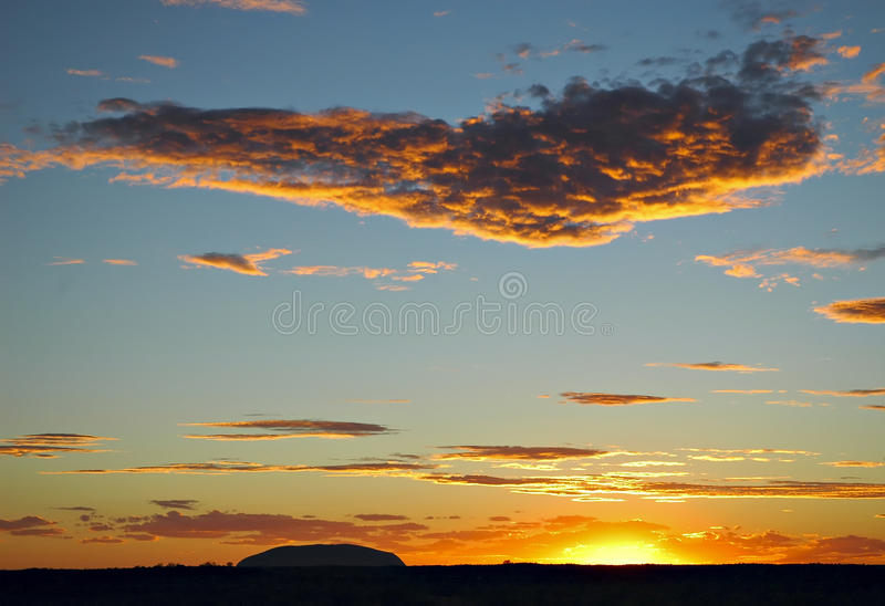 Ayers rock silhouette. Ayers rock during stormy sunset royalty free stock photos