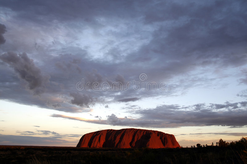 Ayers Rock at sunset. Ayers Rock (Uluru) at the 'golden hour royalty free stock images
