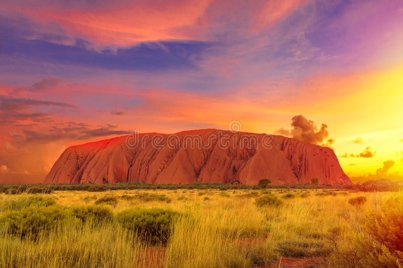 Ayers Rock sunset sky. Colorful clouds at sunset sky over Ayers Rock in Uluru-Kata Tjuta National Park - at Living Cultural Landscape, Australia, Northern stock images
