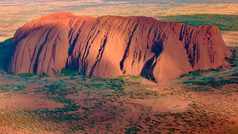 Ayers Rock, Tourist Attraction, glowing Monolith, Australia, aerial view, seen from Heli royalty free stock photo