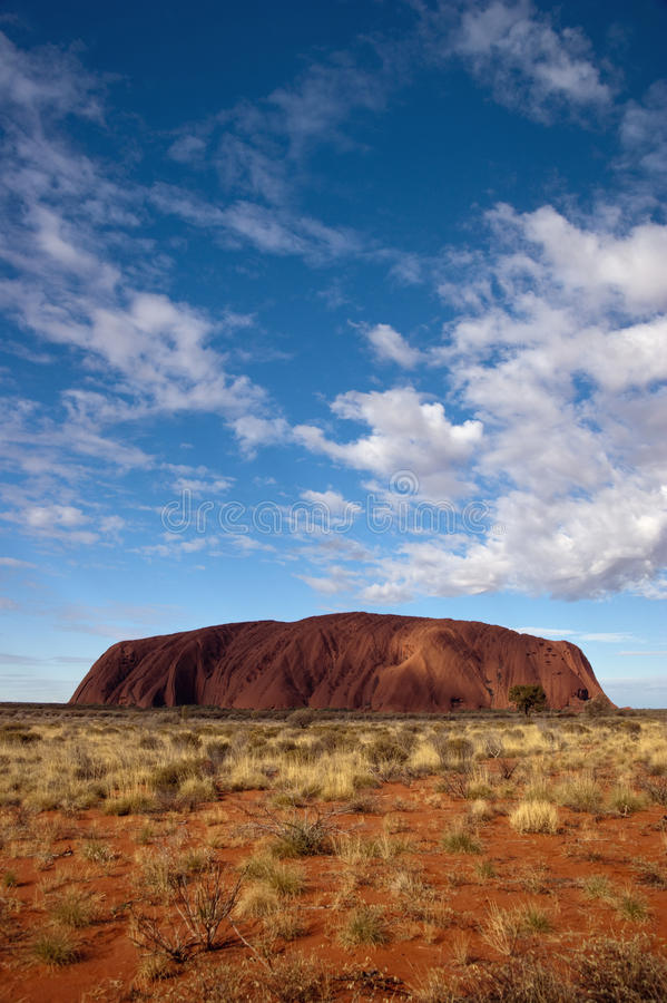 Ayers Rock - Uluru. With cloudy sky royalty free stock photography