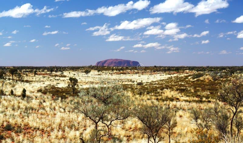 Ayers Rock Uluru and Cloudy Sky