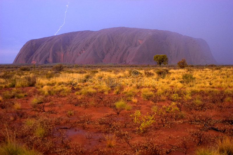 Ayers Rock, Uluru Lightning Strike, Rain Storm. Lightning strike at Uluru, Ayers Rock in Australia. This is an actual image, no Photoshop tricks were used. The royalty free stock photo