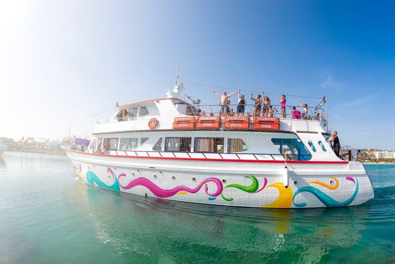 Ayia Napa, Cyprus - April 07, 2019: Cruise sightseeing boat full of tourists entering Ayia Napa harbor stock images