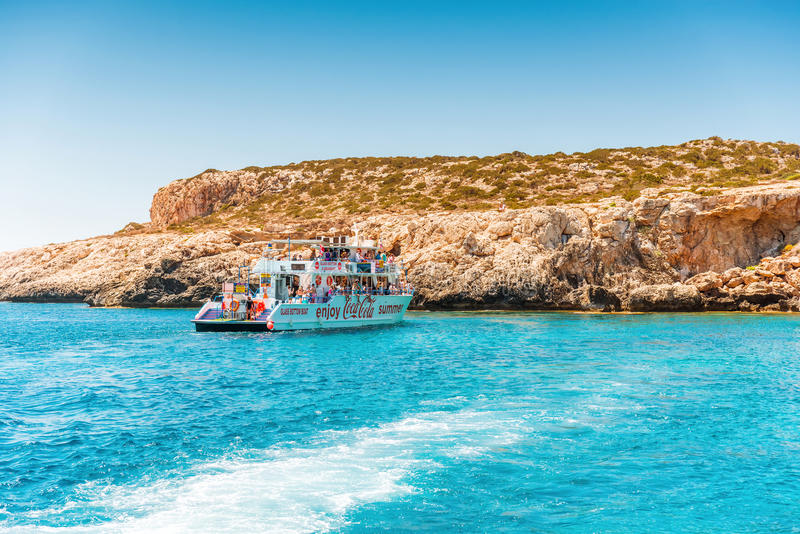 AYIA NAPA, CYPRUS - JULY 16, 2016: Recreational boat with tourists in the waters of the Mediterranean.  royalty free stock photos
