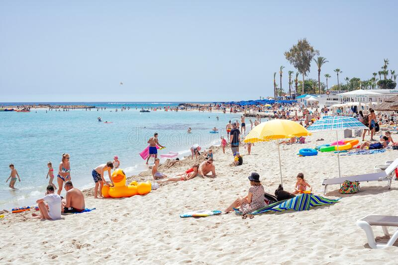 Ayia Napa, Cyprus - July 04, 2018: Tourists and locals enjoying the summer vacations on the Nissi beach stock photo
