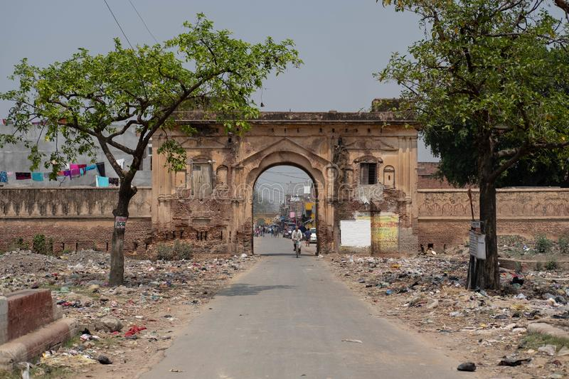 Ayodhya, Uttar Pradesh / India - April 1, 2019: The entrance to a nearby village has piles of trash on either side of the road. royalty free stock image