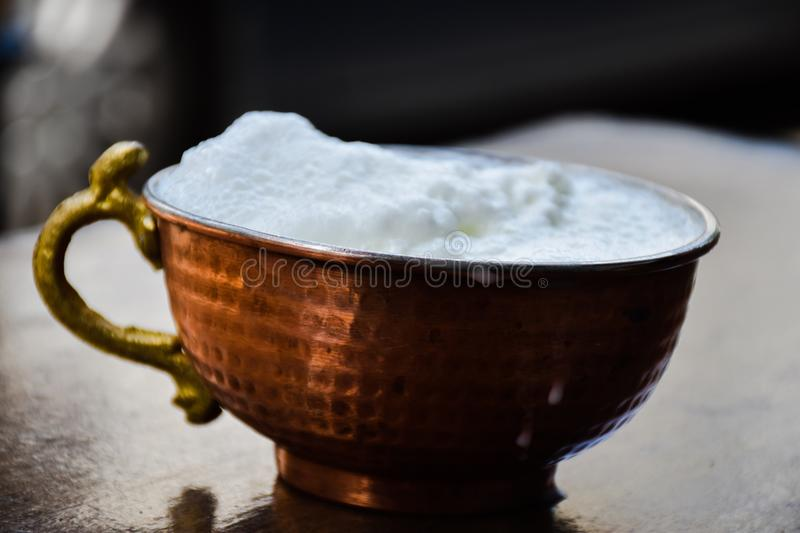 Ayran - Traditional Turkish yoghurt drink in a copper metal cup royalty free stock images