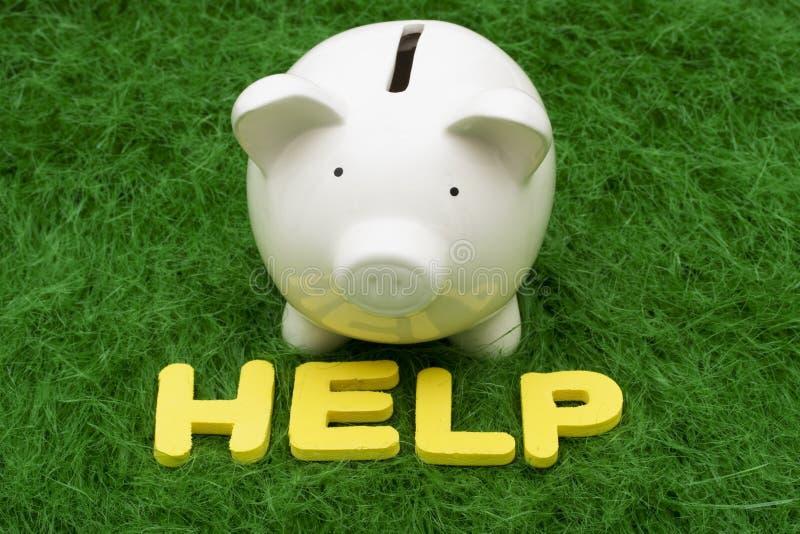 Ayuda de los ahorros foto de archivo libre de regalías