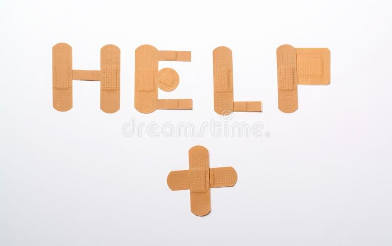 Ayuda de los vendajes foto de archivo