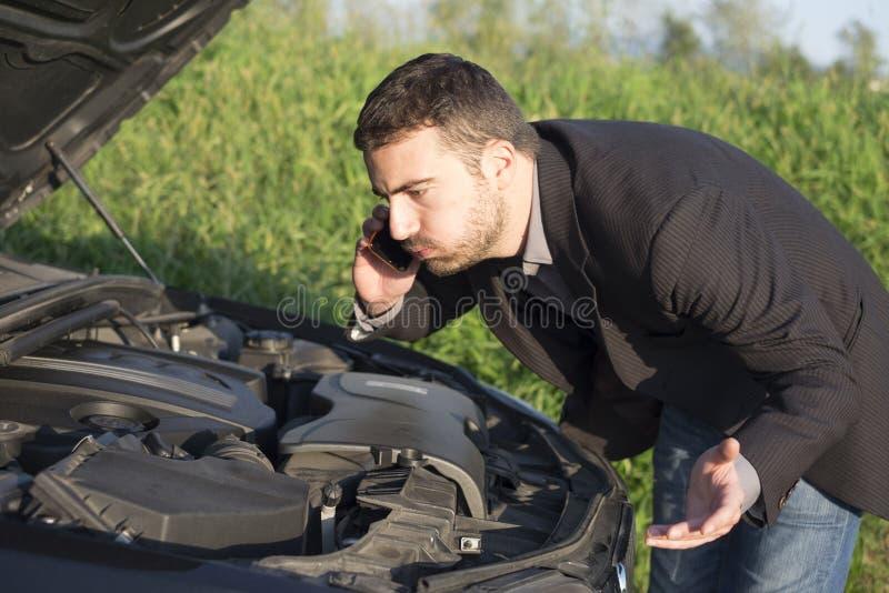 Ayuda del coche imagen de archivo