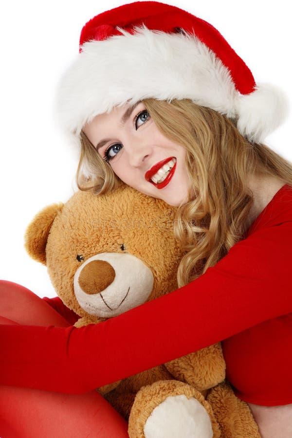 Ayudante de Santa con el oso de peluche fotos de archivo libres de regalías