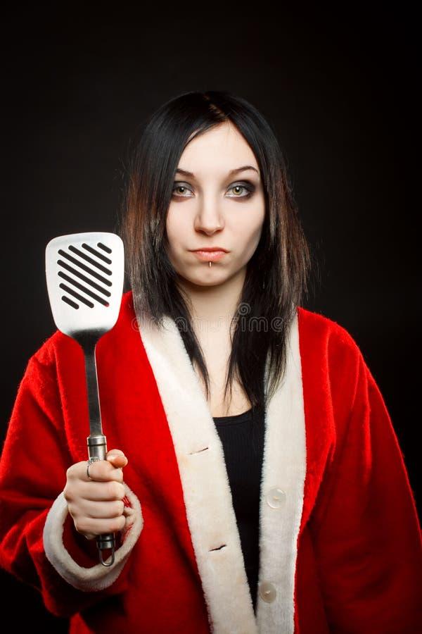 Ayudante de Santa con la espátula fotografía de archivo