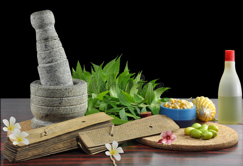 Ayurveda. Traditional ayurveda herbs and manuscript text stock photos