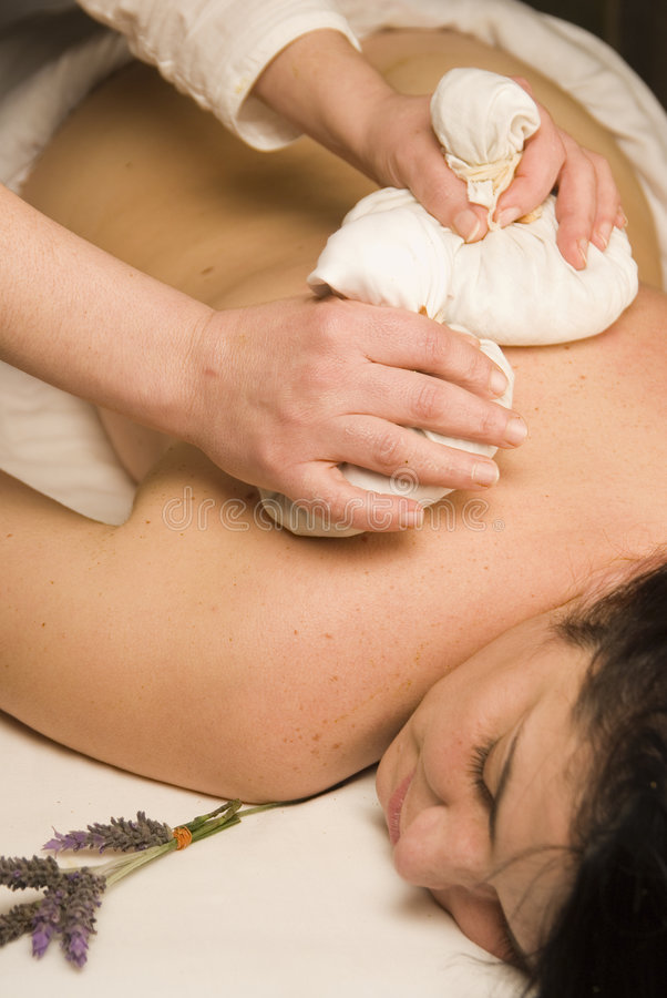 Ayurveda massage with herbs in the spa royalty free stock photos