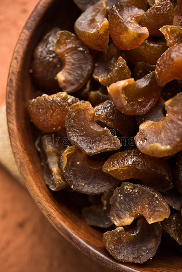Ayurvedic Amla Candy. Which is dried and salty-sweet or chatpata in taste and digestive. Served in a wooden bowl, selective focus stock image
