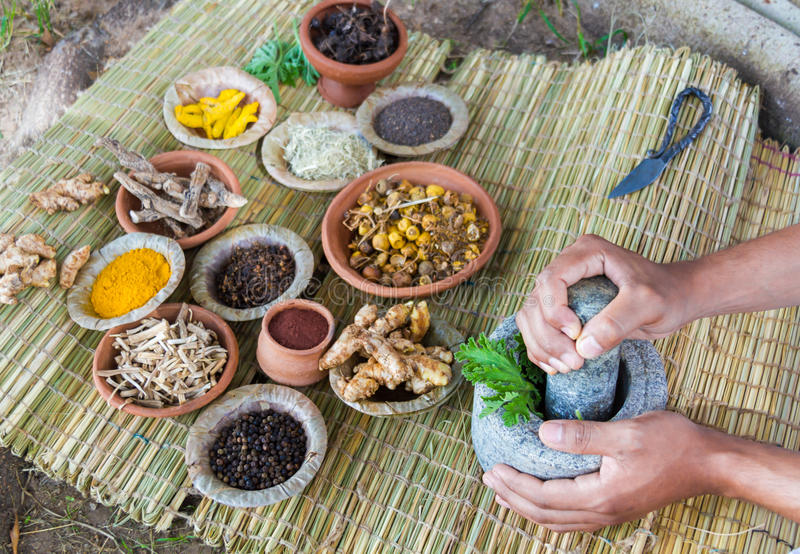 Ayurvedic Doctor. 's hands preparing ayurvedic medicine in the traditional manner in India royalty free stock photo