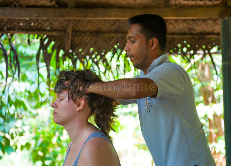 Ayurvedic head massage. For a young woman royalty free stock photo