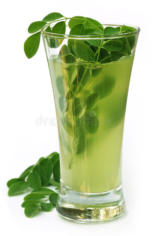 Ayurvedic Juice made from moringa leaves royalty free stock photo