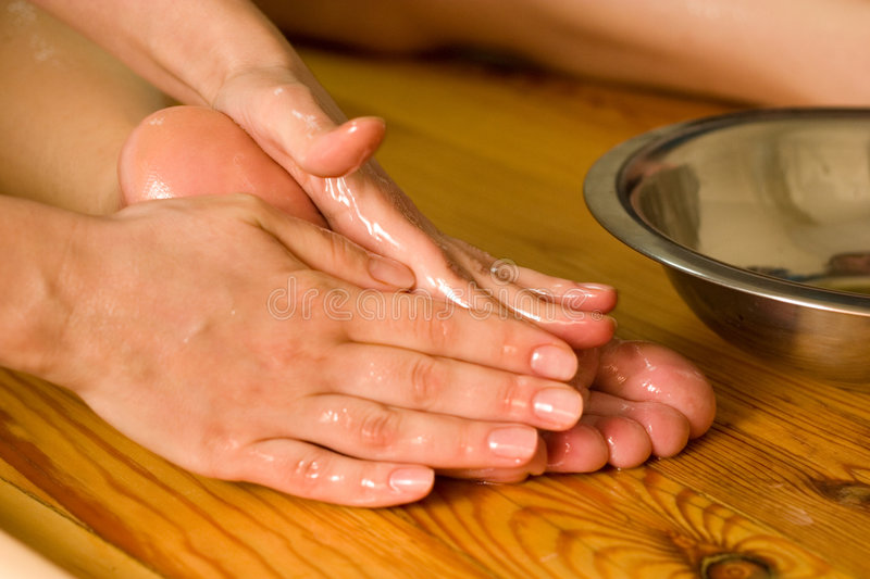 Ayurvedic oil foot massage. Ayurvedic foot therapy massage procedure with oil royalty free stock image