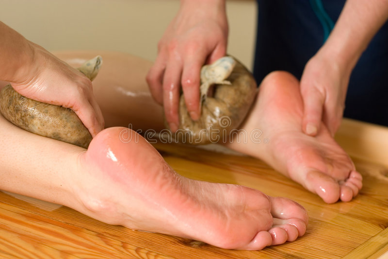 Ayurvedic oil foot massage stock photo
